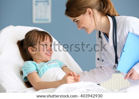 Doctor and little girl in the office