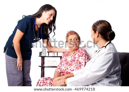 Doctor and Nurse consulting comforting Senior Patient at home health.