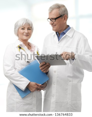 Doctor and nurse with digital tablet working