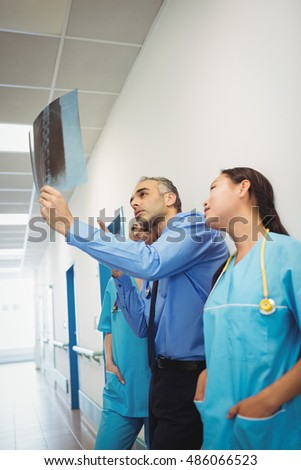 Doctor and nurses looking at x-ray at the hospital