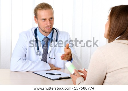 Doctor and patient at office - stock photo