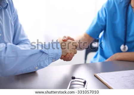 doctor and patient at the table. solution - stock photo