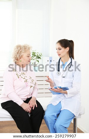 Doctor and patient in hospital clinic