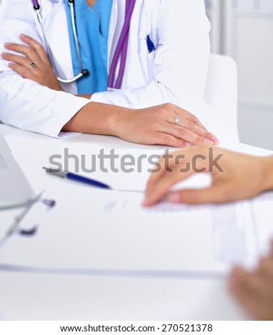 Doctor and patient sitting on the desk  at office . - stock photo