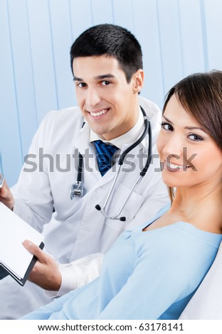 Doctor and patient with prescription at office - stock photo