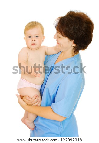 Doctor and small smiling baby isolated - stock photo