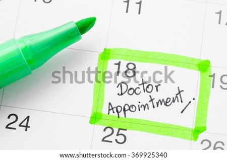 Doctor appointment on calendar. - stock photo