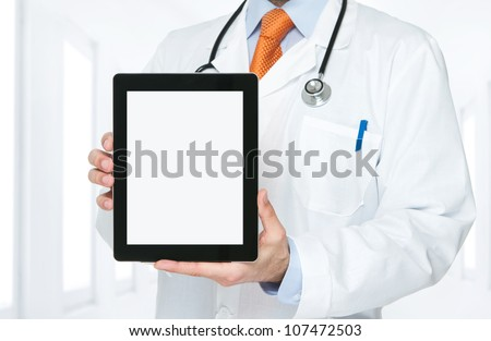 Doctor at hospital holding blank digital tablet with clipping path for the screen