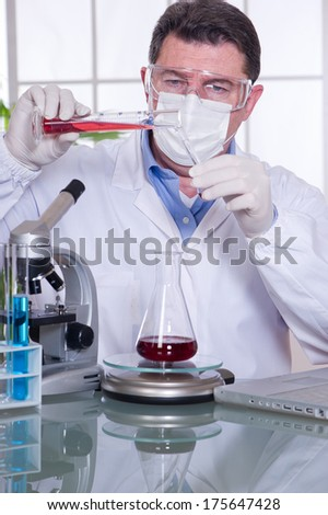 doctor at laboratory blood examination - stock photo