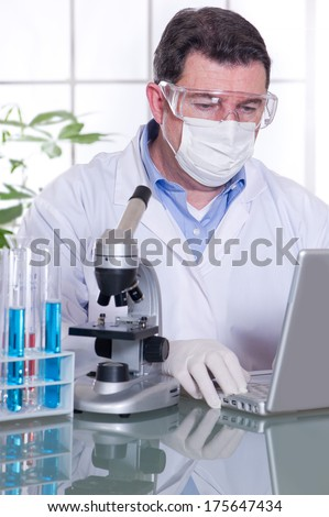 doctor at laboratory with laptop - stock photo