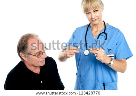 Doctor breaking cigarette. Its injurious to health.