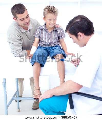Doctor checking a little patient reflexes - stock photo