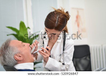 Doctor checking a patients throat