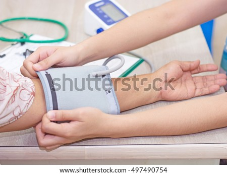 Doctor Checking blood pressure - close up