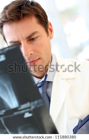 Doctor checking on patient Xray results - stock photo