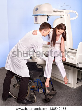 Doctor checking patient  in x-ray room. - stock photo