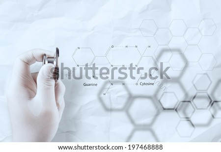 doctor chemist hand showing chemical formulas on crumpled paper  - stock photo