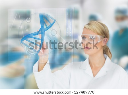 Doctor consulting touchscreen displaying DNA helix diagram during surgery