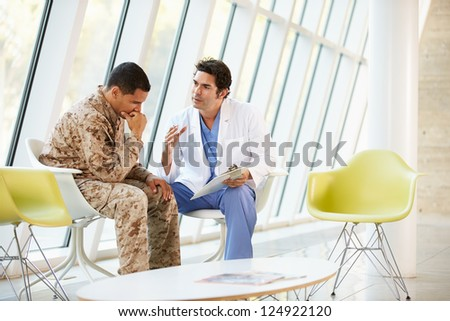 Doctor Counselling Soldier Suffering From Stress
