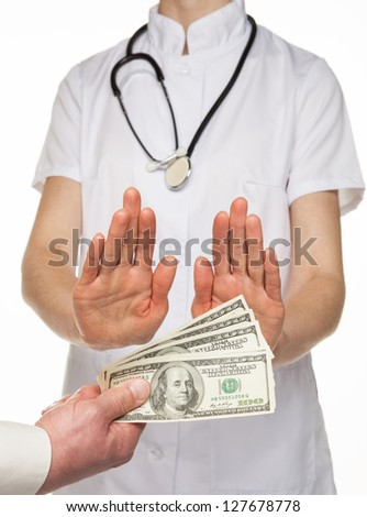 Doctor decidedly refuses to take money from patient, white background - stock photo