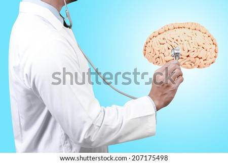 doctor diagnosis with stethoscope listening beat of brain - stock photo