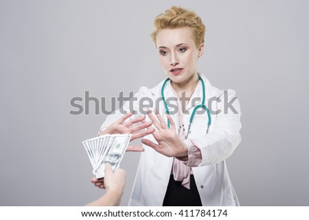 Doctor does not accept the bribe - stock photo