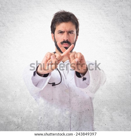 Doctor doing NO gesture over textured background