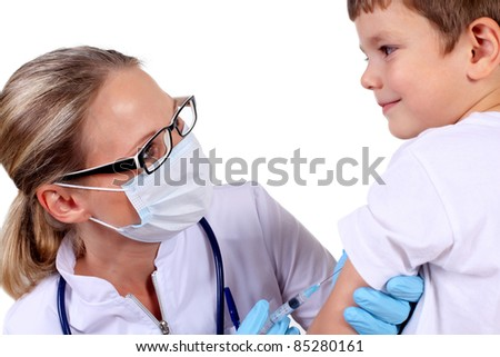 Doctor doing vaccine injection to a child