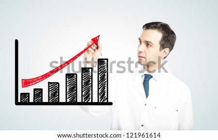 doctor drawing  profit on a white background - stock photo