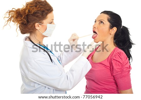 Doctor examine patient woman for sore throat isolated on white background - stock photo