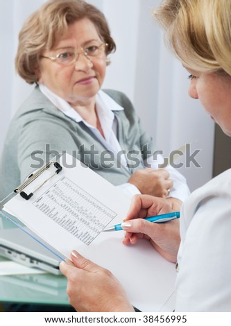 Doctor examines results of blood tests.  Selective focus  on clipboard with test results - stock photo