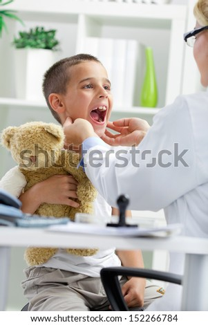 doctor examines the little boy - stock photo