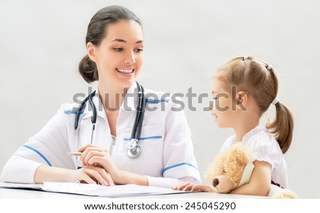 doctor examining a child in a hospital - stock photo