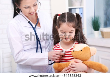 Doctor examining a child in the office