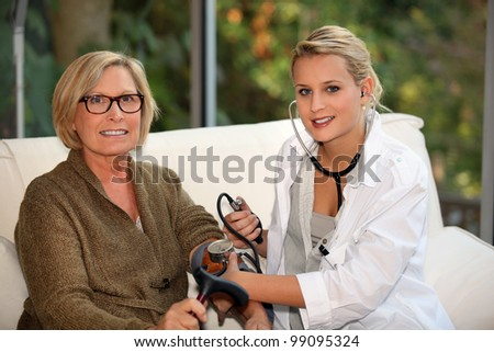 doctor examining a senior woman - stock photo