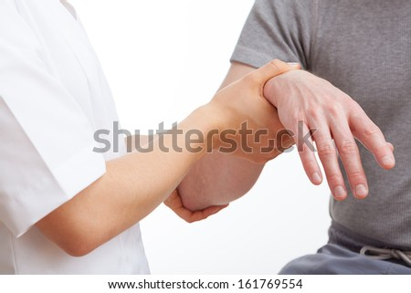 Doctor examining an aching hand