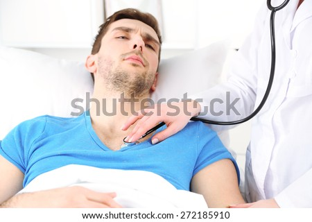 Doctor examining bronchi of patient close up