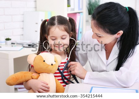 Doctor examining child in the office - stock photo
