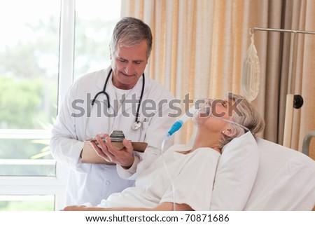 Doctor examining his patient - stock photo