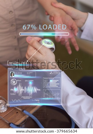 Doctor examining his patient using virtual future technology screen with all data - stock photo