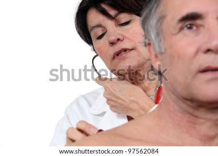 Doctor examining patient - stock photo