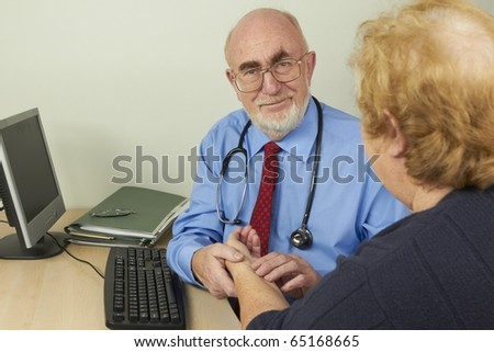 Doctor examining patient in his office - stock photo