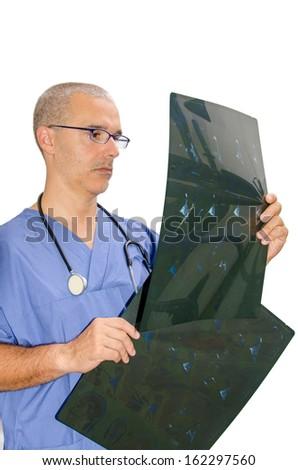 Doctor examining  radiography on white background - stock photo