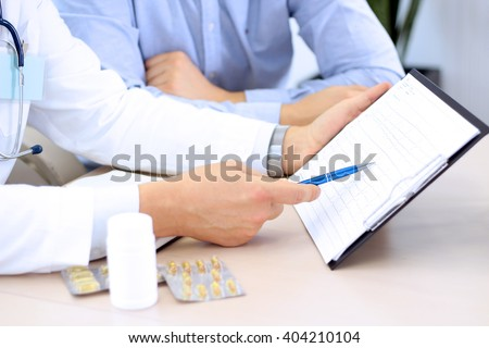doctor explaining diagnosis to male patient - stock photo
