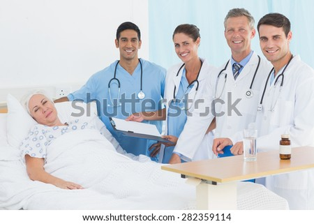 Doctor explaining report to female patient in the hospital - stock photo