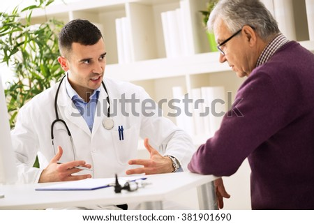 Doctor explains to sick patient about healthy - stock photo