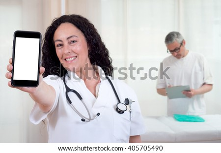 doctor female  with smartphone with blank screen in the hospital