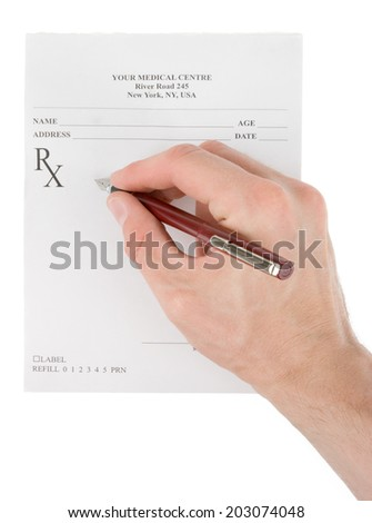Doctor filling in empty medical prescription - stock photo