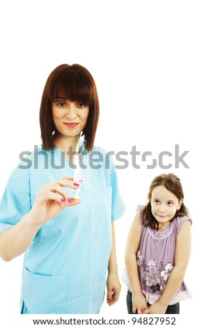 Doctor getting ready to make an injection to a child.  Isolated over white background