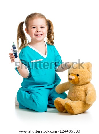 doctor girl playing and measuring  temperature plush toy isolated on white background - stock photo